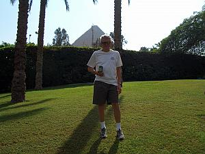 Dad Klocke posing with a Mountain Dew, showing off the Arabic logo. Pyramid in the background.