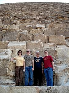 Posing for a photo before we enter the pyramid. Each of those blocks weighs more than a ton (2000 pounds).