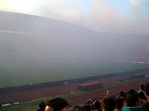 Smoke covering the pitch. It stayed this way for a few minutes - we were surprised they played through it and didn't stop play. We couldn't see the action for a couple minutes.