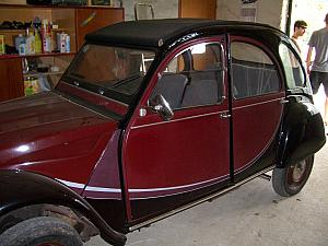 An old Citroen car, in a garage where we picked up our raft.