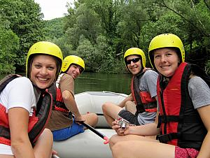 Smiling because we're on the river!