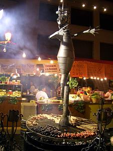 meat cooking on a cool grill for Fiesta de la San Lorenzo - Madrid's version of church festivals!
