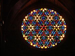 The giant rose window inside the Cathedral of Santa Maria of Palma