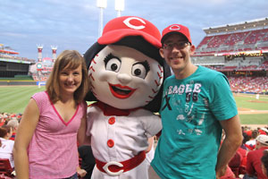 Kelly and Jay with Rosie Red at the Cincinnati Reds game during Sanger & Eby's outing. (Photo Credit: Mike Welch, mikewelch.com)