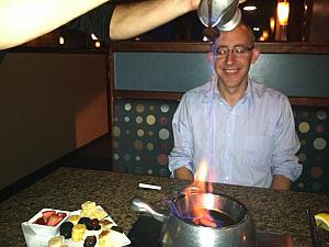 Preparing the chocolate sauce at The Melting Pot.