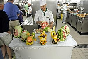 On the ship, taking a galley tour - a fruit carver displaying his amazing work.