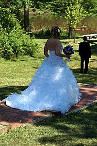 Kyleen walking to meet up with Kevin for the first time in her wedding dress