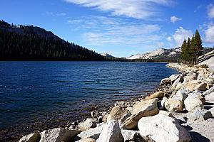 Driving to Tuolumne Meadows, passing a scenic lake.