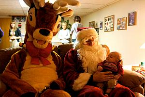 We were lucky enough to receive a visit from Santa and Rudolph! They've been coming to Nana and Papa's house for more than 25 years -- unfortunately Rudolph has upgraded from his aluminum-foil antler suit.