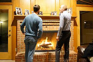 Jay and Mike enjoying the warmth of the fireplace