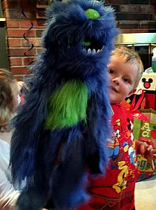 Coopers third birthday -- playing with his furry monster!