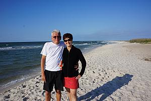 Grammy and Grandpa posing on the beach.