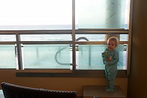 Capri on our balcony, wanting to get into the infinity pool in her PJs