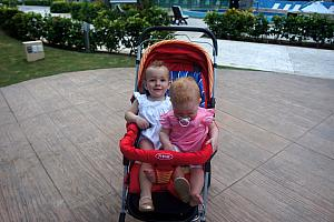 Capri and Kenley sharing a stroller