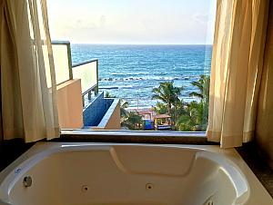 Looking out at the beach from the condo's master bathroom.