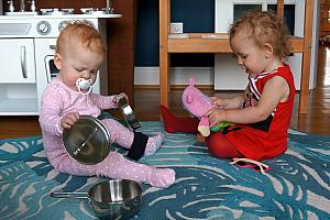 Capri and Kenley playing with the kichen toys