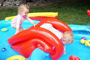 Capri and Kenley playing on the pool slide