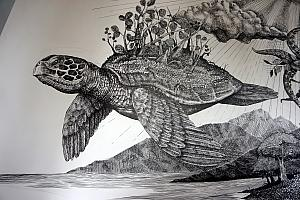 A close up of a turtle in a beautiful mural at the museum entrance.
