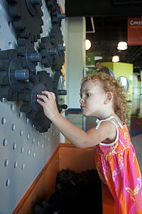 Focused on the gears. Also note in the background dad intensely focused at another exhibit. We all really enjoyed the museum.