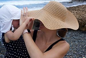 Capri and Mom playing with their hats