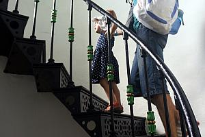 Capri and Dad climbing a spiral staircase, inside a lighthouse.