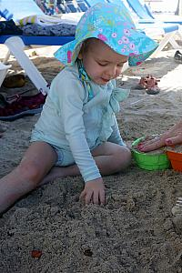 Capri enjoying some sand time.