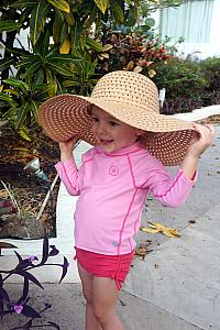 Capri wearing mom's hat!