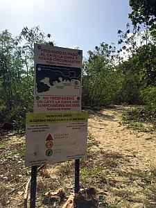 I don't often find notices about explosives at the beach! Background: Vieques island was a U.S. military base from the 1940s until early 2000s. One of its major uses was as a test bombing site. So, these signs are posted all around the perimeter of the don't-ener bombed areas. Don't worry, the beaches themselves are very safe!