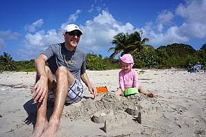 "Capri and Dad building ""sea castles""!"
