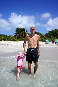 Capri and grandpa walking in the water.