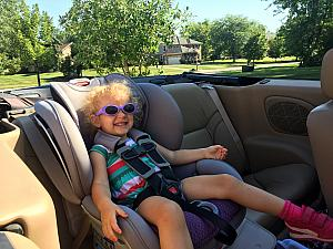 Capri taking a convertible ride to the swim club =)