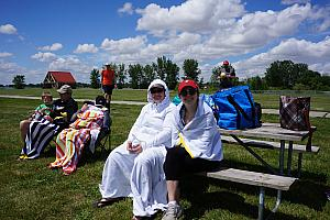 Some of the adults all bundled up in their beach towels :). It was in the 60s and very windy this day (we had summer weather a couple days later)