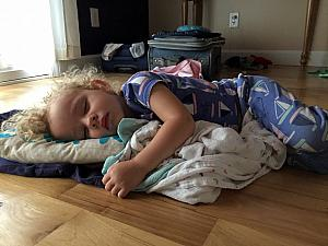 This is what happens when Dad puts Capri down for a nap - she gets cranky and ends up sleeping on the floor instead (=