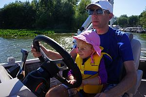 Capri and Dad driving the boat