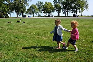 Capri and Kenley running to see the geese