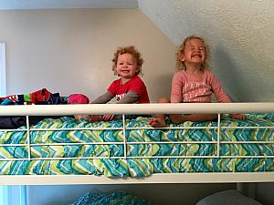 Capri and Kenley having fun on the top bunk of the bunk bed.